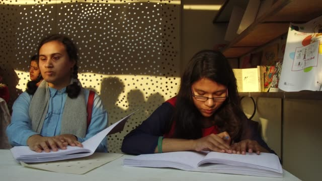 visually impaired youths going through braille version of books at book fair in dhaka, bangladesh, on february 10, 2018. according to the academy... - visual impairment stock videos & royalty-free footage