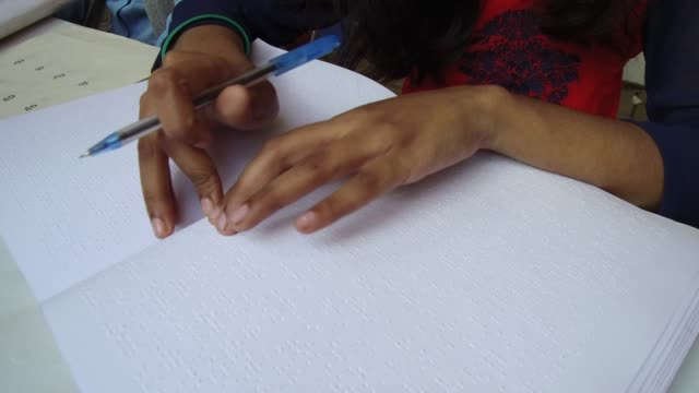 visually impaired youths going through braille version of books at book fair in dhaka bangladesh on february 10 2018 according to the academy... - visual impairment bildbanksvideor och videomaterial från bakom kulisserna