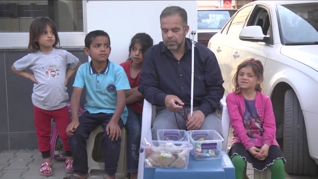 visuallyimpaired syrian abdulgaffar kassab 41yearold who fled his home after a barrel bomb destroyed it in syria try to live under harsh conditions... - visual impairment stock videos & royalty-free footage