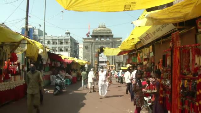 vidéos et rushes de visuals of a shop at the little market outside shri tulja bhavani temple in tuljapur, maharashtra, on november 5, 2020. framed pictures of the... - fidèle religieux