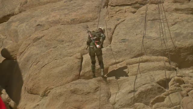 visuals of an indian army soldier practicing on the hills at leh in ladakh the soldier can be seen trying to get off the cliff holding firmly on the... - indian army stock videos & royalty-free footage