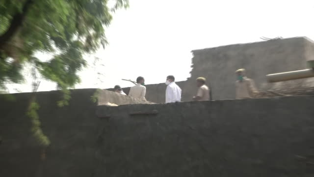 visuals of the special investigation team on a rooftop working on the hathras incident a 19year old girl was allegedly gangraped in up on 14th... - uttar pradesh stock videos & royalty-free footage
