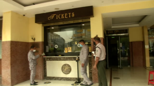 visuals of the ticket window and the entrance of a pvr cinema hall in delhi, on october 15, 2020. the sanitizer stand and social distancing marks are... - shot put stock videos & royalty-free footage