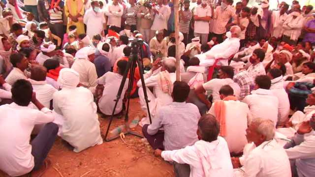 visuals of the villagers gathered together in large numbers as they sat on a strike seeking justice for the hindu priest who was burnt alive in the... - number of people stock videos & royalty-free footage