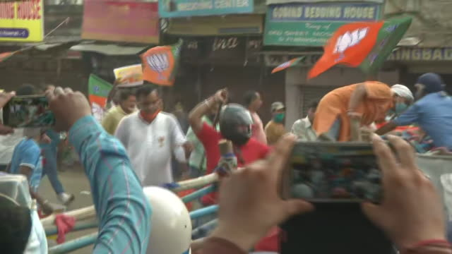 visuals of the youth wing of the bharatiya janata party marching towards nabanna in howrah, west bengal. a large number of protestors can be seen... - flagpole stock videos & royalty-free footage