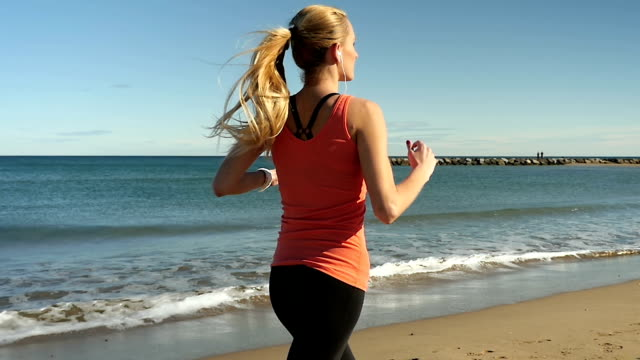 Vital beautiful running along coastline