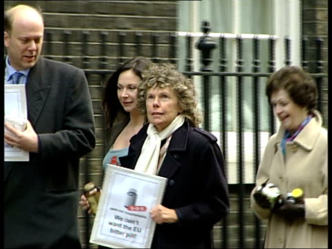 EU Directive to withdraw products from sale ENGLAND London Downing Street EXT Carole Caplin carrying jars of vitamin tablets along to No 10 Downing...