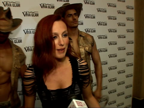 viva glam party for the mac aids fund: red carpet interviews; siobhan donaghy posing for photocall with 'cowboy' male models then speaking to press... - only girls stock videos & royalty-free footage
