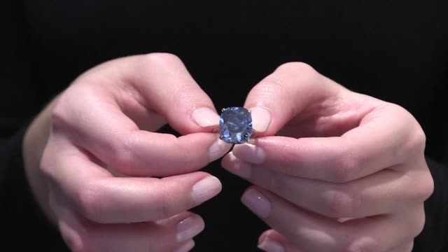 a vivid 1203 carat diamond dubbed blue moon was sold in geneva for a record 432 million swiss francs on wednesday auction house sothebys said - sotheby's stock videos and b-roll footage