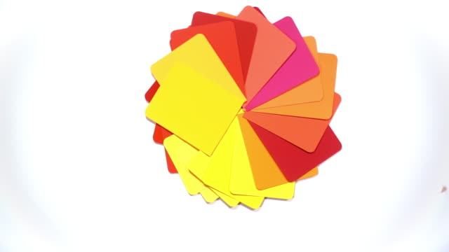a vivid and saturated selection of colour swatches spin to reveal a white background. - david ewing stock videos & royalty-free footage