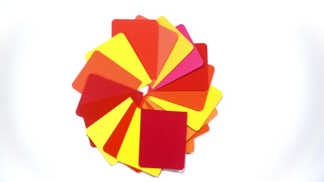 a vivid and saturated selection of colour swatches spin to reveal a white background. - saturated colour stock videos & royalty-free footage