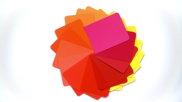 A vivid and saturated selection of colour swatches spin to reveal a white background.