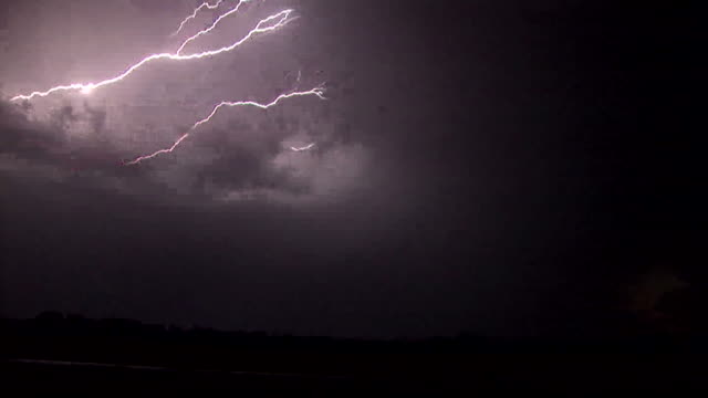 Vivid forked lightning shoots across the night sky in rural Oklahoma during the height of tornado season
