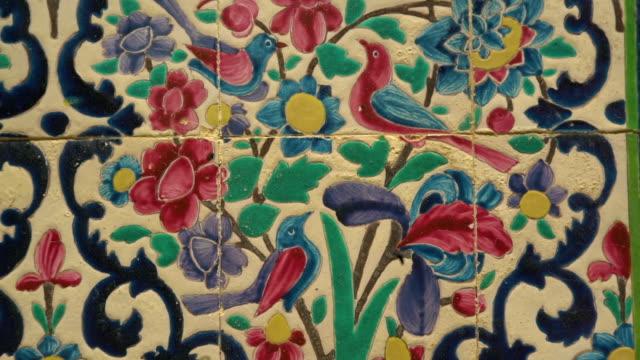 a vivid mosaic wall of birds and flowers - pälsteckning bildbanksvideor och videomaterial från bakom kulisserna