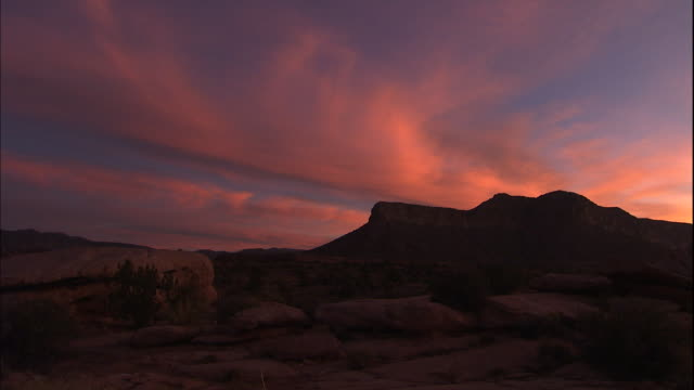 vivid orange clouds fill the sky above the grand canyon. - southwest usa video stock e b–roll