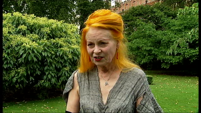 vivienne westwood to attend prince of wales' garden party: westwood interview; dame vivienne westwood interview sot - talks of arriving by bicycle /... - wearing a towel stock videos & royalty-free footage