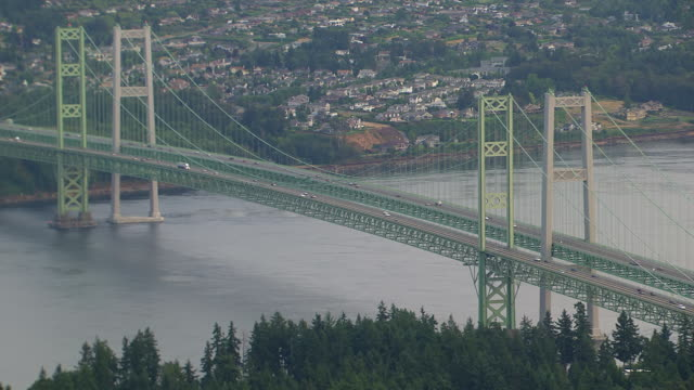 WS AERIAL ZI Viwe of cars moving on Tacoma Narrows bridge / Tacoma, Washington, United States