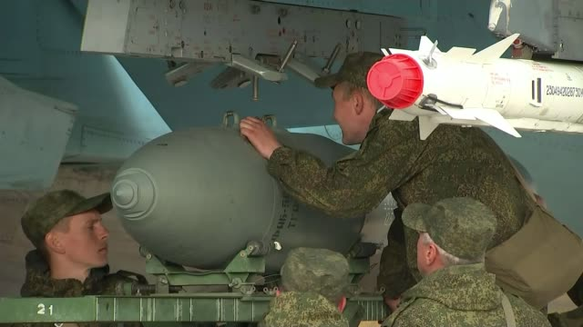 Vladimir Putin announces that Russian troops to be withdrawn T20011603 / 2012016 Russian soldiers loading bomb onto aircraft Russian fighter ircraft...