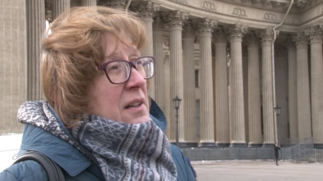 Vladimir Putin prepares for upcoming Russian election Kazan Cathedral dome and colonnade TILT Diana Kachalova interview SOT Various shots protesters...