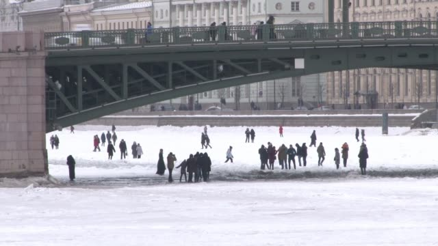 Vladimir Putin prepares for upcoming Russian election RUSSIA St Petersburg Various shots people on frozenover Neva river Various shots Church of the...