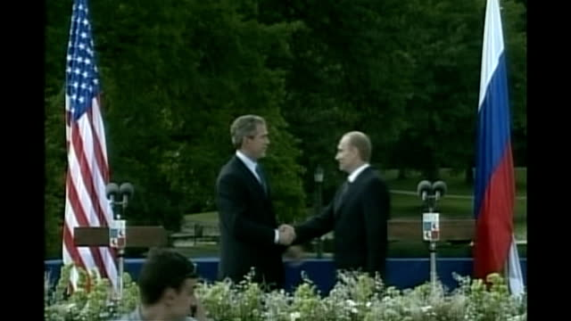 Vladimir Putin visit to US presidential holiday home LIB Brdo Castle EXT General view of castle Bush and Putin shaking hands at photocall George W...