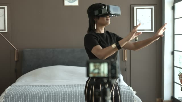 vlogger making video of using vr goggles at home - cyberspace stock videos & royalty-free footage