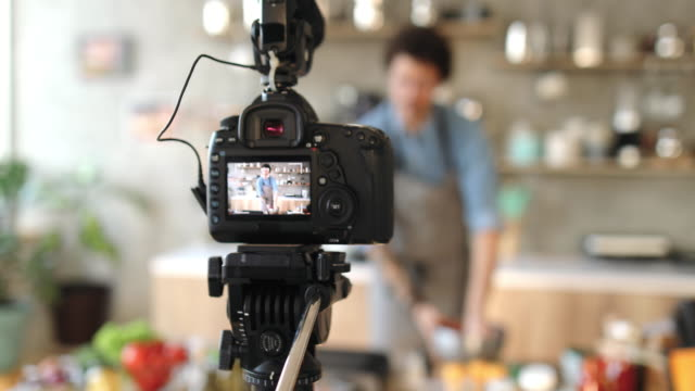 vlogging about food preparation - filming stock videos & royalty-free footage