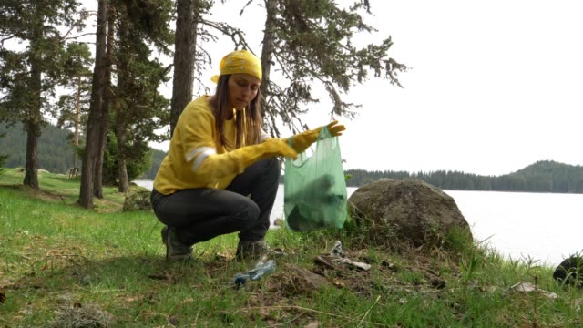 ms vlogging. take care of nature and local cleaning. learning to preserve it from destruction. youtube vlogger, instagram tv - picking up stock videos & royalty-free footage