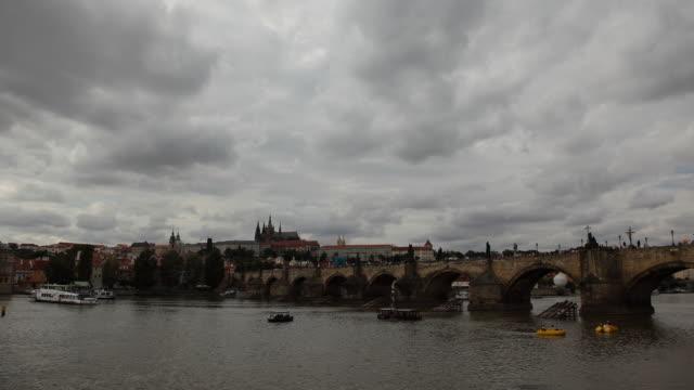 t/l ws vltava river and charles bridge / prague, czech republic - river vltava stock videos & royalty-free footage