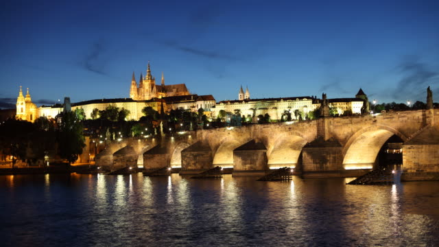 T/L WS Vltava river and Hradcany Castle, dusk to night / Prague, Czech Republic