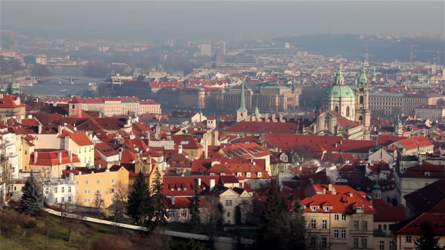 vltava river, bridges, red roofs & st. nicholas church - river vltava stock videos & royalty-free footage