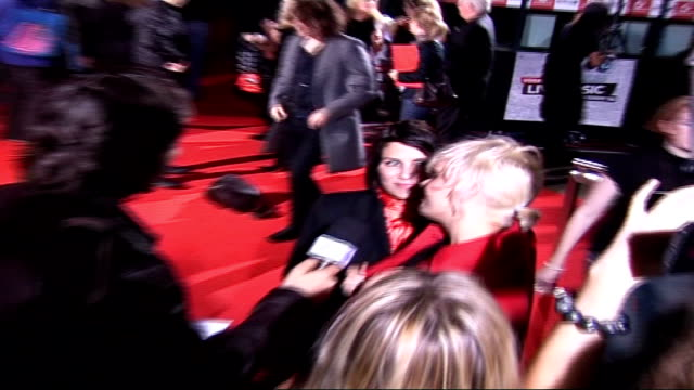 celebrities on red carpet Sadie Frost wearing red shirt and black jacket and Mairead wearing red jacket arriving speaking to press SOT