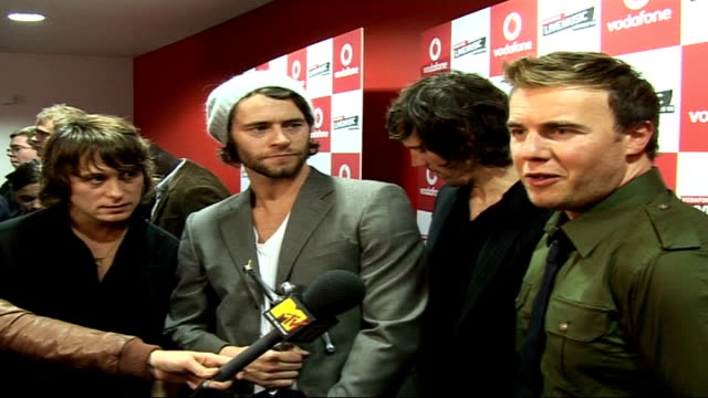interviews and photocalls backstage take that members mark owen howard donald jason orange and gary barlow interview sot on returning to live scene... - boy band stock videos & royalty-free footage