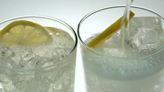 cu vodka pouring in glass with ice / estepona, malaga - lemon stock videos & royalty-free footage