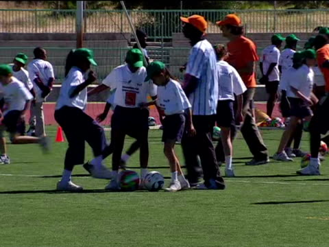 prince william has been showing off his football skills in botswanathe prince was at the maun stadium in the north of botswana to take part in... - stabilimento sportivo video stock e b–roll