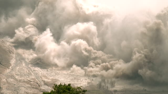 Volcanic ash and lava spew from Sinabung volcano in Sumatra Indonesia during a violent eruption on 19th June 2015