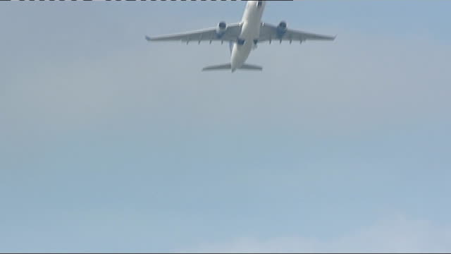 volcanic cloud of ash closes british airspace general views heathrow airport iberia airlines plane taking off from runway / plane flying overhead /... - cenere video stock e b–roll