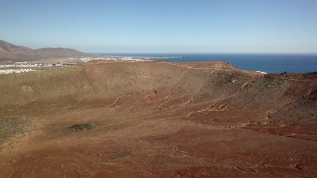 volcanic crater montaña roja in front of the town playa blanca on lanzarote - atlantic islands stock videos & royalty-free footage