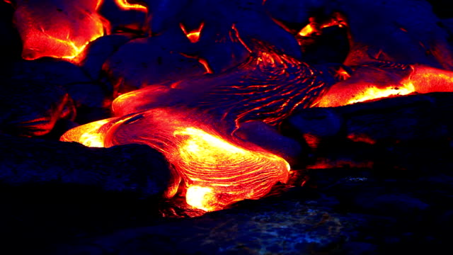 Volcanic lava Flowing at night