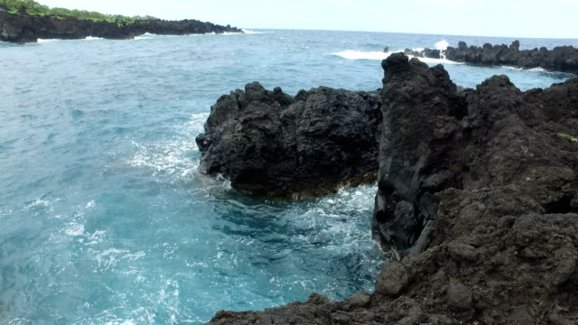 volcanic rock coastline on maui island - butte rocky outcrop stock videos & royalty-free footage