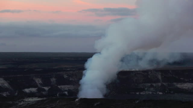 ws t/l volcanic smoke drifts at dawn / halemaumau crater, hawaii, usa - caldera stock videos and b-roll footage