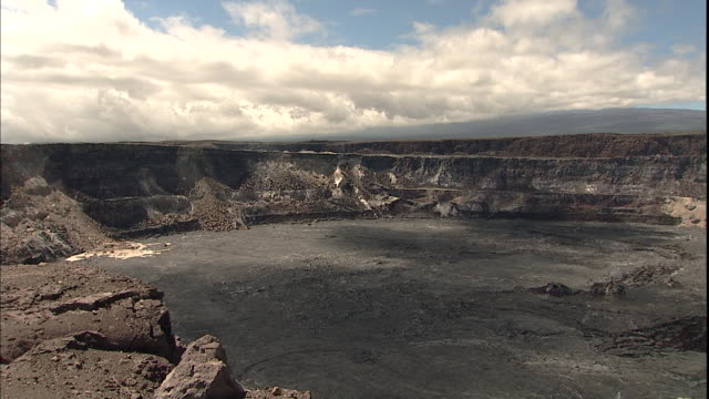 a volcano crater typifies volcanoes national park  in hilo, hawaii. - kilauea stock videos & royalty-free footage