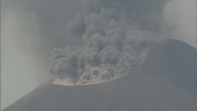 a volcano emits smoke. - erupting stock videos & royalty-free footage