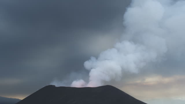 volcano erupting, lava visible, surrounded by ash, nyamuragira, democratic republic of congo, 2011 - erupting stock videos & royalty-free footage