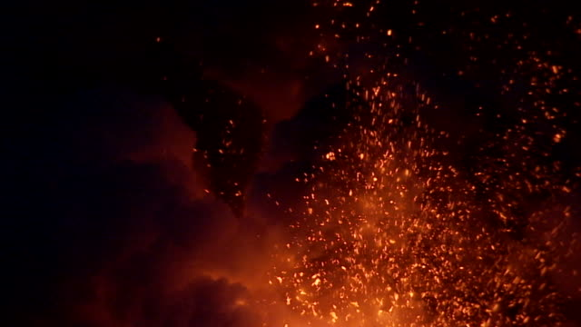 a volcano erupts at night. - hot spring stock videos & royalty-free footage