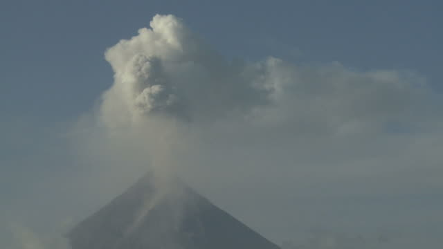 Volcano erupts large ash cloud into clear blue sky, Philippines, Dec 2009