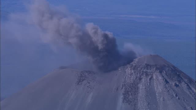 A volcano in the Kamchatka Peninsula spews ash.