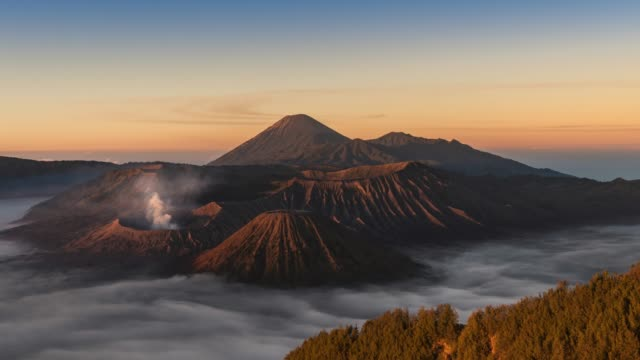 volcano landscape with move on the sea of fog in the morning at bromo tengger semeru national park - tengger stock videos & royalty-free footage