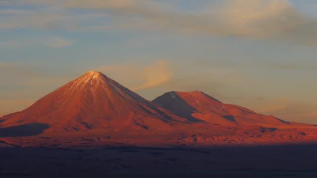 volcano licancabur during sunset, medium shot - antofagasta region stock videos and b-roll footage