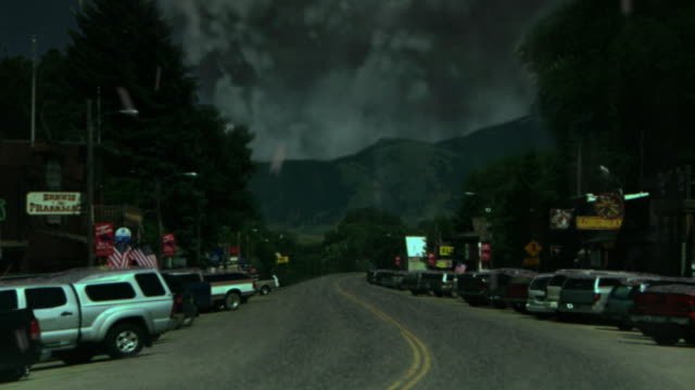 a volcano spews ash and debris over a town. - digital animation stock videos & royalty-free footage